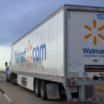 A Walmart freight delivery truck traveling on the Interstate