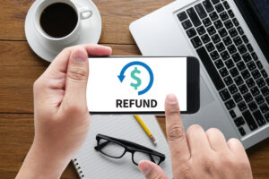 the word refund written on a phone screen