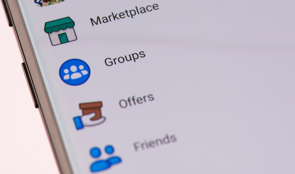 Facebook marketplace logo on smartphone screen background close up view