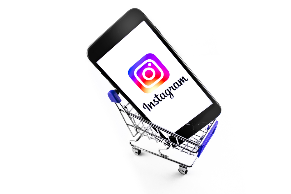 iPhone with Instagram logo in shopping cart.